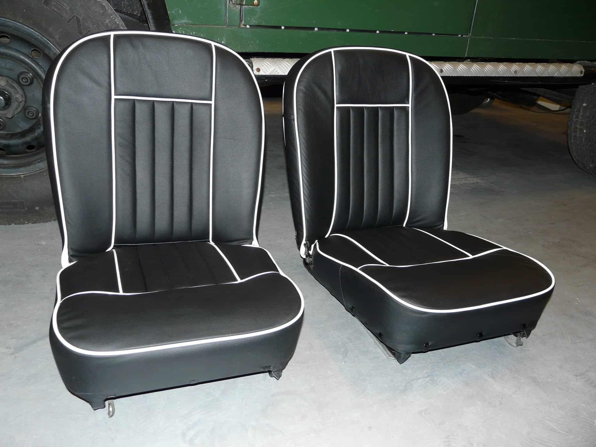 Zwart lederen stoelen met witte bies mg parts benelux for Lederen stoelen